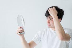 men-looking-mirror