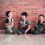 photo-of-boys-sitting-on-floor